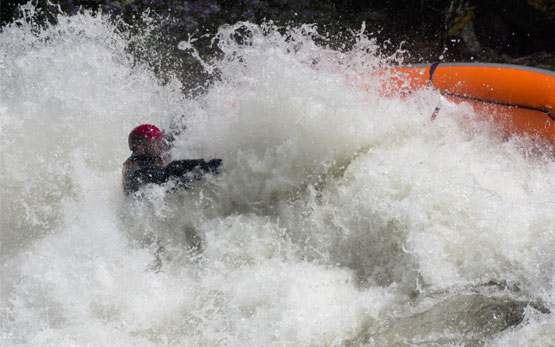 Whitewater Raft Flips in River Hole