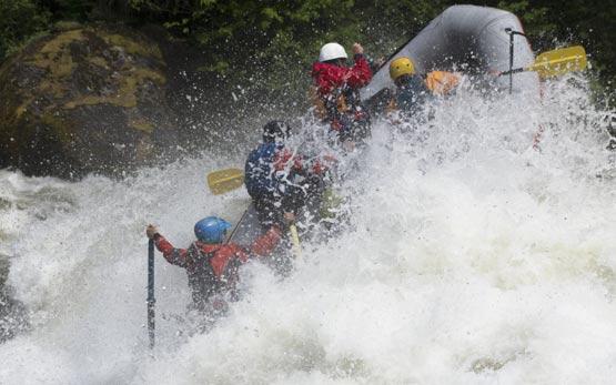 Whitewater Raft punching deep hole